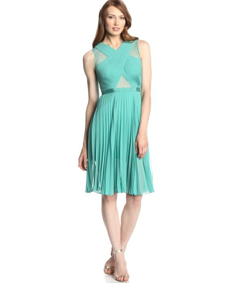 green pleat summer dress for wedding guest with lace inserts by BCBGMAXAZRIA