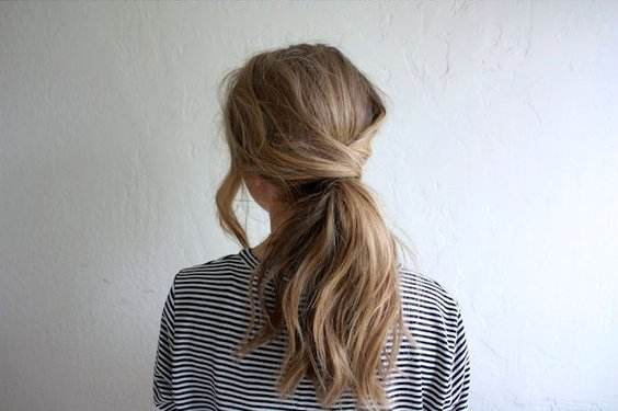 easy ponytail with a twist summer hairstyle